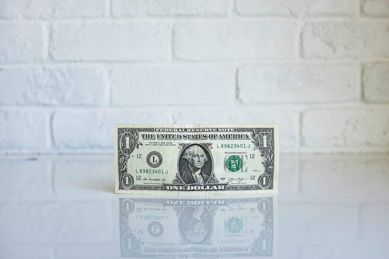 Dollar bill on white surface